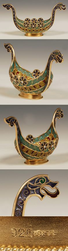 A Norwegian silver gilt and plique-a-jour enamel Viking boat, David Andersen, circa 1900. Of traditional form, the boat decorated with translucent shades of green, purple, red and yellow enamel with flower inspired round shields around the upper rim, finished with a dragon's head and tail