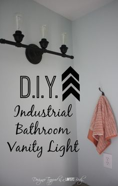 BRILLIANT!  Easy DIY update to create beautiful industrial bathroom lighting for less than $30!  You won't believe what this fixture looked like before!