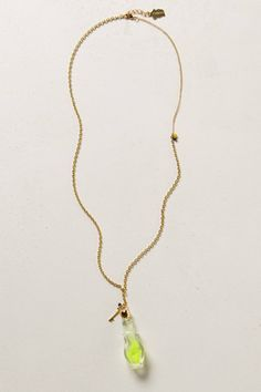 I like how this necklace utilizes 2 different types of chains, as well as the little key charm by the bottle. The bottle has a little piece of silk in the water, too. (Eau de Seine Pendant Necklace - anthropologie.com)