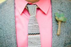 Groom in a grey suit with a pink shirt and succulent boutonniere @myweddingdotcom