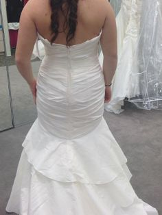 This is a beautiful taffeta mermaid gown. Never worn, the pictures are of me in the salon. and unaltered size 12. I'm typically a street size 8 so fits a range of people. I fell in love with it only after a month if being engaged and came across another gown later that is more suited for my theme and venue. It has a dropped waist, tiered bottom, scoop neck with off shoulder straps, also has a shear sash attached   This listing includes a size 14 slip for the dress and a veil with ivory ...