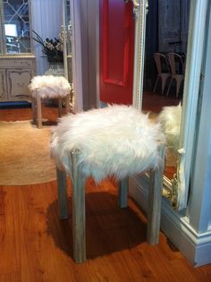 Faux Fur and Wood stools ($268 per stool) available at Dress and Dwell 138 Spring St. New Albany, In   https://www.facebook.com/dressdwell