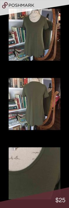 NWOT LuLaRoe small green classic tee Have to destash! Removed tags but never worn green small classic tee with high low hem. You can downsize 1-2 sizes on this shirt as they run a bit big.  Soft and comfortable short sleeve top to wear with your leggings jeans shorts pants skirts.   Please check out my other quality listings. All sales final, no return for size. Cross posted. Price is FIRM. Get it now, I'm only here for a limited time  Tags: rose animals carly maxi perfect tunics nicole…