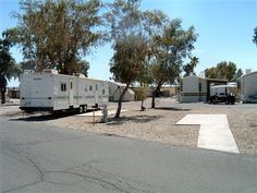 BEACHCOMBER RV RESORT - LAKE HAVASU CITY, ARIZONA: My neighboorhood for the winter. Where the trailer is will be my space for 2012-2013. My boat is less that 100 yards away at the marina.