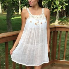 This exclusive beautiful white cover up dress with crochet detailing on the top is from Havana Cuba! Wear this over your favorite bathing suit this summer and pair with your favorite sandals. This cou