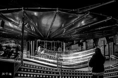 A young girl decides whether she'll brave the 'Waltzer' in the Woodstock Funfair in Oxfordshire.