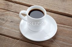 black coffee on wooden plank. - Close-up shot of black coffee cup on wooden plank.