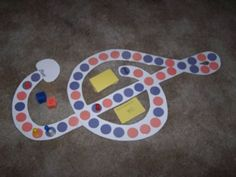 This is the first game I ever made for my studio and it is still one of the favorites. I just cut a treble clef shape out of white posterboard and then cut orange and blue circles and placed them o…