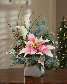 Poinsettia & Calla Lily Silk Flower Arrangement Make something like this for craft shows. It just reminds me nostalgically Christmas Flower Arrangements, Artificial Floral Arrangements, Christmas Flowers, Silk Flower Arrangements, Christmas Centerpieces, Floral Centerpieces, Christmas Wreaths, Christmas Decorations, Xmas