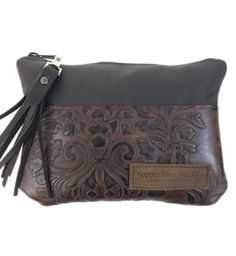 This simple, sophisticated clutch is handcrafted in Italian leather with a botanical paisley design. Perfect for dressing up or for carrying just the essentials. Carry the clutch on its own or use it as an organizer inside your Copper River Bag. Leather Clutch Purse   Copper River Bag Co: http://www.copperriverbags.com/leather-clutch-2/