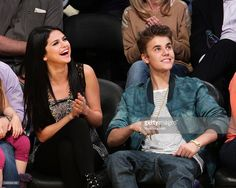 Selena Gomez (L) and Justin Bieber attend a basketball game between the San Antonio Spurs and the Los Angeles Lakers at Staples Center on April 17, 2012 in Los Angeles, California.