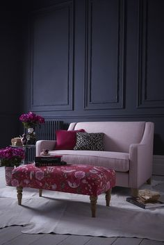 Black contrast can look friendly and feminine. The light pink really pops in front of the black wall and the darker pink ottoman is really an eye catcher. Monsoon Home Collection by Multiyork - Image L
