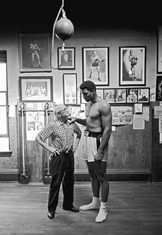 Muhammad Ali & Johnny Coulon. The Champ visits Johnny Coulon at Coulon's Gym in Woodlawn (1154 E. 63rd). Coulon ran the gym from 1923 until retiring in '73 (at which point his student Clarence Griffin took over), and its descendant, the Windy City Boxing Club, is the center of boxing in Chicago.  Johnny was also the 1910 Bantamweight Champion.