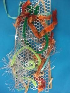 Weaving is a great activity for developing fine motor skills and eye hand coordination. We did some freeweaving using textured wools, ribbons and pipe cleaners through metallic honeycomb mesh.