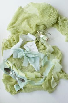 This romantic green lime hand dyed fabric styling selection, which is perfect for wedding decoration, stationary styling and as a newborn flat lay photo prop, comes with:  - lime cotton gauze runner of 70 cm / 28 inches wide and 3,5 m / 3,8 yards in length - light green sage silk