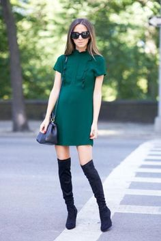 Tall boots were made for short sweater dresses. Pick a color that flatters your skin tone, we love this jade green on Arielle of Something Navy, and slip in to your black tall boots. Accessorize minimally.