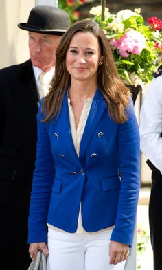 Pippa Middleton let down her half-up royal wedding hairstyle in favor of this more natural side-parted layered 'do.