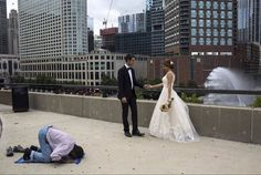5d A Muslim taxi driver praying while two Iranian students celebrate their wedding day Photo by Hossein Fatemi on winning the 2017 World Press Photo, long-term projects category. World Press Photo Foundation is an independent, non-profit organization which is known for holding an annual press photography contest.