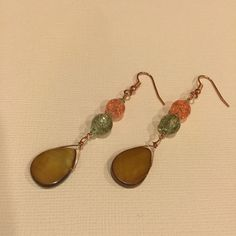 "Handmade Shell & Glass Earrings Enjoy these beautiful handmade copper earrings. They are embellished with green and orange crackled glass and a teardrop shaped piece of brown mother of pearl. They measure 2.75"" long. Jewelry Earrings"