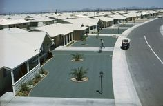 Homes built for a retirees have green gravel lawns, James P. Blair.