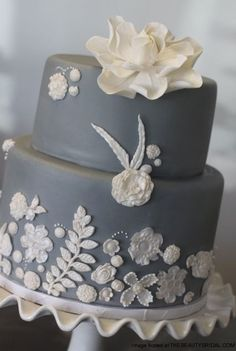 Google Image Result for http://thebeautybridal.com/wp-content/uploads/2011/08/Grey-White-Sugar-Flower-Wedding-Cake.jpg