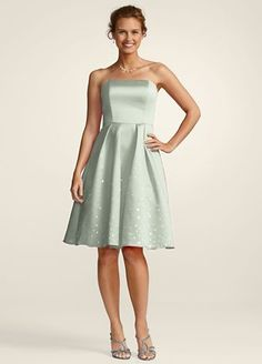 This flirty little satin dress is right on trend with paillette details on the skirt that add sparkle and flair. The full skirt and fitted bodice make a statement while the strapless top keeps the look young and fresh. Sizes and colors may have limited availability and may vary by store.