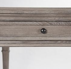 This French country wooden dining table is a large, stately piece crafted with delicate, period features so it won't overwhelm your room.  The antique grey limed finish gives it a texture that hints at a past life and works as well in your rustic cottage as it will in a modern industrial loft.  As a beautiful bonus, two drawers allow you to store dining utensils or other dining accouterments for easy access. Also works as a stately desk.