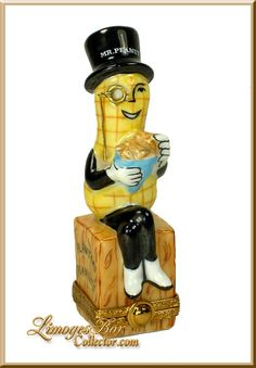 PEANUT seated on a crate of PLANTERS PEANUTS. Description from limogesboxcollector.com. I searched for this on bing.com/images