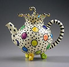 What a beautiful teapot! Living color, great stripe appeal, eye catching polka dots.