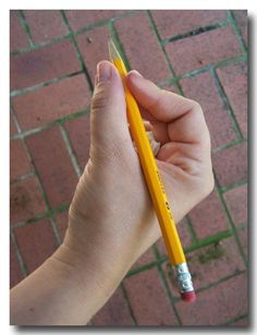 A trick to teach kids how to hold their pencil the correct way. Holy cow! This is great!  This will be awesome for my kinders!