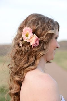 Natural wavy bridal hairstyle with flowers   Anna Gleave Photography   see more on: http://burnettsboards.com/2014/05/pink-ombre-wedding-whimsical-details/ #bride #hairstyle