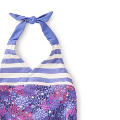 Bells Beach Halter One-Piece | Bells Beach is one of the most popular spots for surfing in Australia. It's also known to be a great place to visit to soak up the seaside sun. This pretty purple print reminds us of a rich vibrant sunset over the water's edge.