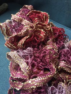 The reds, pinks, and light purples with the gold sequins really makes this scarf beautiful. The sequins are well placed so they arent overbearing,