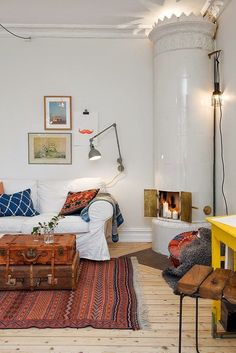 Eclectic Boho Scandinavian modern apartment with nicely staged Swedish stove // Kakelugn: Ode to the Swedish Stove