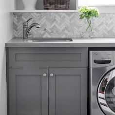 Laundry room with herringbone tile backsplash, herringbone tiles, (calcutta marble herringbone tiles) Laundry Room Design, Laundry In Bathroom, Laundry Area, Small Laundry, Basement Laundry, Laundry Closet, Gray Laundry Rooms, Hidden Laundry, Laundry Tubs