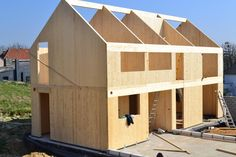 A single family house under construction with glulam and cross laminated timber