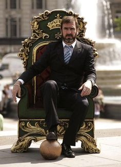 Eric Cantona on a throne of futbol
