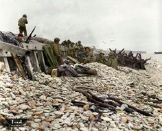 D Day plus one June On the shingle of Omaha Beach Dog White sector, at Saint-Laurent sur Mer, Normandy. (Colorized by Dave Ford) Battle Of Normandy, D Day Normandy, Normandy Beach, Le Mont St Michel, D Day Landings, Story Of The World, War Photography, Dog Beach, Historical Pictures