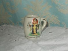 tiny cup , £3.00 by lovelocks whatknots:   tiny cup in lovely condition the cup measures a height of around 2-3CM's, the front has the picture of a saint to the front.
