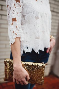lace top, shimmery clutch