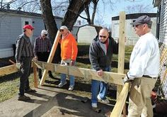 Members of the First United Methodist Church of Dover Rev. Dave Kowaleski (Left) Ron Wallick, Dan Clark, Dick Rothrock and Don Foltz work on the deck at 124 Seagull Lane, New Philadelphia on Good Friday.