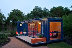 "This shipping container micro dwelling in San Antonio, which measures 320 square feet, it's as ""green"" as the exterior paint is blue, with an electric composting toilet, a water-reclaiming system that nourishes the rooftop garden, and a porch made of recycled air-conditioner equipment pads."