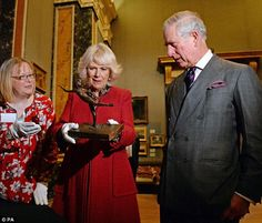 Prince Charles and Camilla looked fascinated as they admired exhibits at the Fitzwilliam Museum in Cambridge this afternoon. Pictured: Camilla holds a sculpture by Edgar Degas
