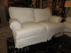 "Price: $525.00 | Item #: 41586  White slip covered loveseat. Couldn't you just see this in a beachfront home! Such a cool, coastal style. At time of posting, we do have the matching sofa. Measurements are 69"" long x 36"" deep x 36"" high..."