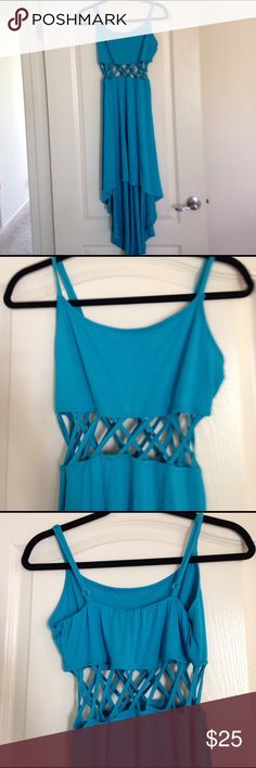 Summer Boutique Dress with Crisscross At Mid rift. Summer Boutique Dress with Crisscross At Mid rift.  70% Polyester, 25% rayon and 4% spandex. Perfect condition . Never Worn. Dresses High Low