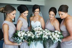 Amy, the beautiful bride, dressed her bridal party in our Exclusive Ingrid Dress in Latte. This dress was designed by Pia Gladys Perey and has been featured in Cosmopolitan Bride. The exclusive Ingrid dress is a one shoulder draped dress with an elastic stretch waist and a wrap style skirt that drapes and splits when you walk. It is a very flattering style available in standard colours and can be Custom Coloured in a colour of your choice.