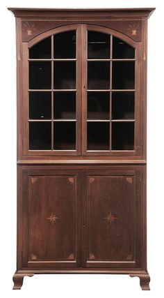Important Tennessee Federal Inlaid Cherry Cupboard - attributed to Greene or Washington County, Tennessee, 1800-1810, cherry and poplar with yellow pine secondary, one-piece construction with arched glazed upper doors flanked by rope and tassel and flowerpot inlay, lower doors paneled with quarter-fan and compass star inlays, 92-1/2 x 43-1/4 x 16-1/4 in.