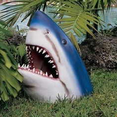 Perfect to be eating pirates in a broken boat - WANT!! The Great Shark Statue by Design Toscano,