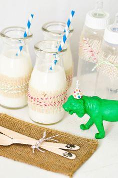 Milk bottles from a Jungle 1st Birthday Party via Kara's Party Ideas