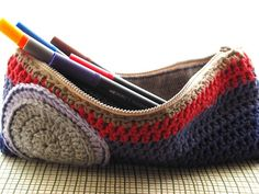 Crocheted cotton pencil case with handwoven wool lining.